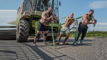 Social Room: Ex-World champ Frank Staebler boasts superhuman strength, pulls 12 ton combine harvester